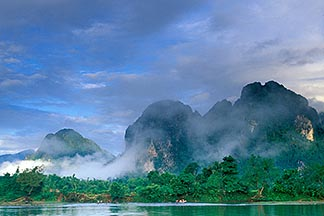 8-580-1 stock photo of Laos, Vang Vieng, Morning mist on the river