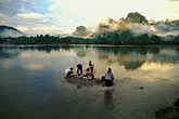 horizontal stock photography | Laos, Vang Vieng, Women washing clothes in the river, image id 8-581-31