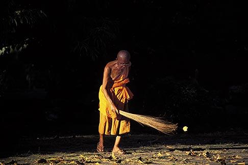 8-601-8  stock photo of Laos, Luang Prabang, Monk sweeping, Wat Xieng Thong