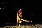 horizontal stock photography | Laos, Luang Prabang, Monk sweeping, Wat Xieng Thong, image id 8-601-8