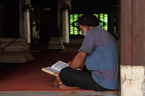 image 7-571-33 Malaysia, Malacca, Man reading the Koran, Kampong Kling Mosque