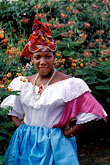vertical stock photography | Martinique, Fort de France, Martinican woman in traditional dress, image id 8-295-9