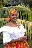 vertical stock photography | Martinique, Fort de France, Martinican woman in traditional dress, image id 8-314-6