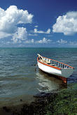 vertical stock photography | Mauritius, Fishing boat, Trou d