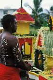 vertical stock photography | Mauritius, Cavadee Festival, A devotee prays before his walk, image id 9-220-55