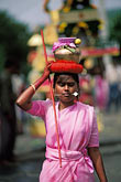 one person stock photography | Mauritius, Cavadee Festival, A woman devotee carrying  a sambo  of milk, image id 9-221-27
