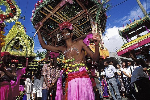 image 9-221-6 Mauritius, Cavadee Festival, Devotee carrying a wooden cavadee