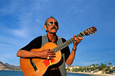polaroid glasses stock photography | Mexico, La Paz, Man playing guitar, image id 0-81-64