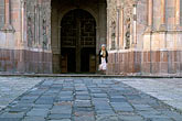 service stock photography | Mexico, San Miguel de Allende, Woman leaving La Parroquia church after service, image id 4-262-15