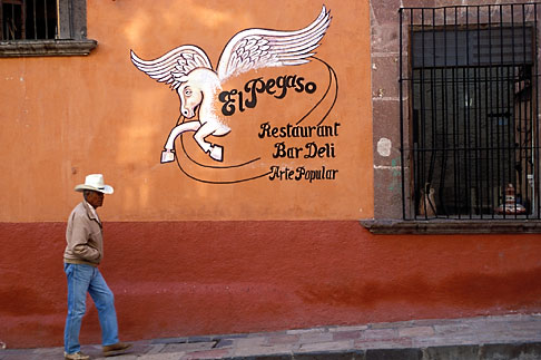 4-263-29  stock photo of Mexico, San Miguel de Allende, Man on street outside El Pegaso restaurant