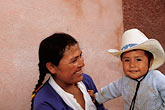 happy stock photography | Mexico, San Miguel de Allende, Street vendor from San Ildefonso with her son, image id 4-283-3