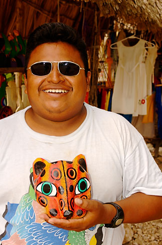 image 4-850-2795 Mexico, Riviera Maya, Artisan with jaguar mask