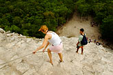 ancient stock photography | Mexico, Yucatan, Coba, climbing El Castillo, image id 4-850-2869