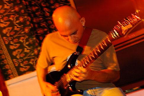 image 4-850-3995 Mexico, Playa del Carmen, Rock musician in cafe