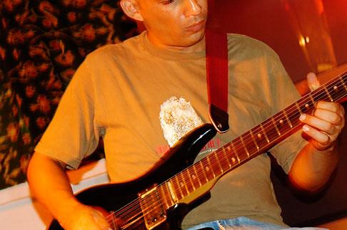 image 4-850-4012 Mexico, Playa del Carmen, Rock musician in cafe