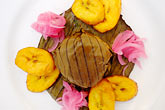 image 4-850-5117 Mexican Food, Cochinita Pibil, banana leaf wrapped pork cooked barbacoa style