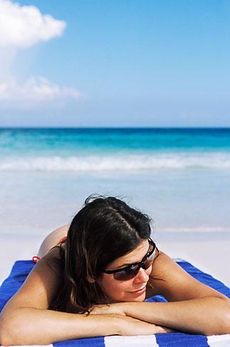 image 4-882-31 Mexico, Riviera Maya, Xpu Ha Beach, woman sunbathing