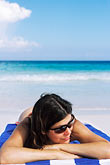 stripe stock photography | Mexico, Riviera Maya, Xpu Ha Beach, woman sunbathing, image id 4-882-31