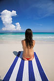 quiet stock photography | Mexico, Riviera Maya, Xpu Ha Beach, woman sunbathing, image id 4-882-38