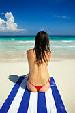 quiet stock photography | Mexico, Riviera Maya, Xpu Ha Beach, woman sunbathing, image id 4-882-4