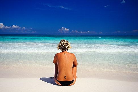 image 4-882-55 Mexico, Riviera Maya, Xpu Ha Beach, woman sunbathing