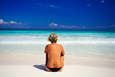 stripe stock photography | Mexico, Riviera Maya, Xpu Ha Beach, woman sunbathing, image id 4-882-55