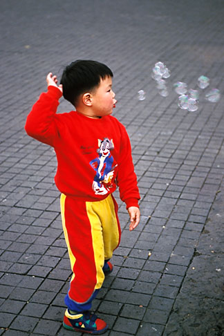 image 5-63-25 Mexico, Mexico City, Boy playing with bubbles, Coyoacan
