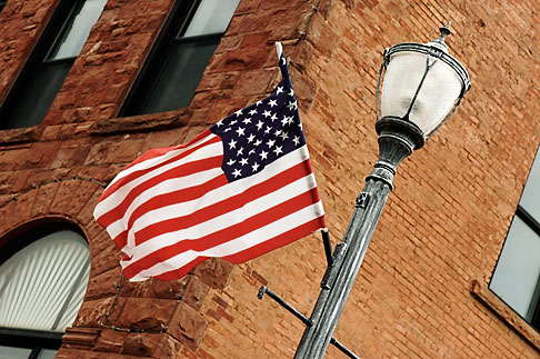 image 4-940-914 Michigan, Upper Peninsula, Flag on Lamppost