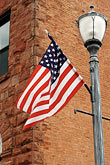 us flag stock photography | Michigan, Upper Peninsula, Munising, Flag, image id 4-940-917