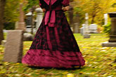 the end stock photography | Canada, Montreal, Mount Royal Cemetery, woman with period dress, walking, low angle view, image id 6-460-7500