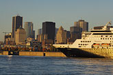 dusk stock photography | Canada, Montreal, Cruise ship in St. Lawrence River and Montreal skyline, image id 6-460-7658
