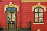 red house stock photography | Canada, Montreal, Front door and window, row house, image id 6-460-8034