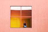 contemporary stock photography | New Mexico, Santa Fe, Lady in window, College of Santa Fe, image id S4-350-1727