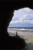 person stock photography | Niue, Tautu sea cave, Liku, image id 9-500-66