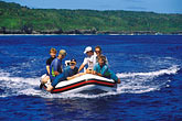 learn stock photography | Niue, Tourists in Zodiac boat, image id 9-505-41