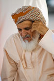 elderly stock photography | Oman, Buraimi, Omani man, seated, with traditional massar headcloth, image id 8-730-1821