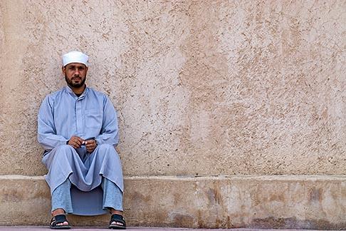 image 8-730-1836 Oman, Buraimi, Arab man, seated against wall