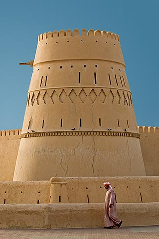 image 8-730-1855 Oman, Buraimi, Al Khandaq Fort, with man in traditional dress, walking