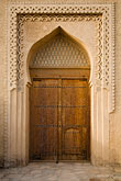 vertical stock photography | Oman, Buraimi, Al Khandaq Fort, Decorated entrance gate, image id 8-730-9840