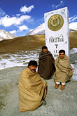 three men stock photography | Pakistan, Karakoram Highway, Khunjerab Pass on the border with China , image id 4-443-12