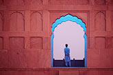 red stock photography | Pakistan, Lahore, Early morning meditation, Badshahi Mosque, image id 4-466-34