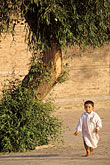 young stock photography | Pakistan, Multan, Young boy playing in courtyard, image id 4-477-27