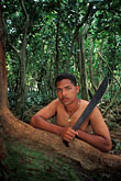 south pacific stock photography | Palau, Angaur, Man in rainforest with machete, image id 8-127-23