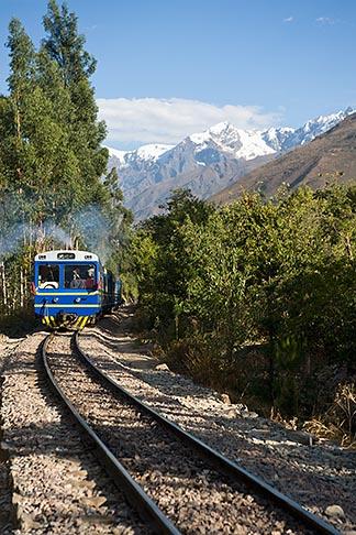 image 8-760-1768 Peru, Ollantaytambo, Peru Rail train in Urumamba valley, snow covered Andes peaks in background