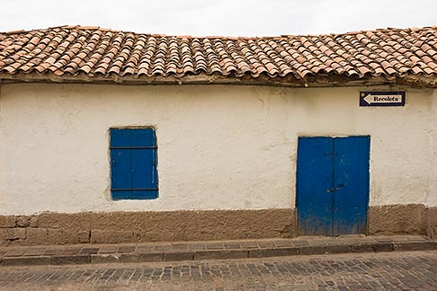 image 8-760-742 Peru, Cuzco, Red tiled building with whitewashed walls and shuttered blue door