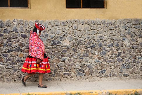 image 8-761-1373 Peru, Ollantaytambo, Quechua woman in traditional dress and hat, walking