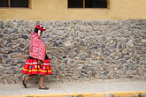 travel stock photography | Peru, Ollantaytambo, Quechua woman in traditional dress and hat, walking, image id 8-761-1373
