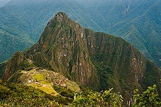 8-761-1656  stock photo of Peru, Machu Picchu, Huayna Picchu peak and Machu Picchu Inca site from high on Machu Picchu Peak