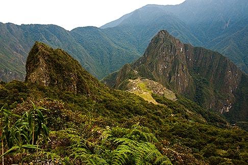 image 8-761-1661 Peru, Machu Picchu, Huayna Picchu peak and Machu Picchu Inca site from high on Machu Picchu Peak