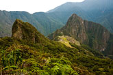 peruvian stock photography | Peru, Machu Picchu, Huayna Picchu peak and Machu Picchu Inca site from high on Machu Picchu Peak, image id 8-761-1661